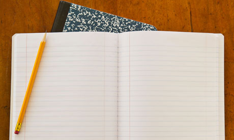 Open notebook with yellow pencil
